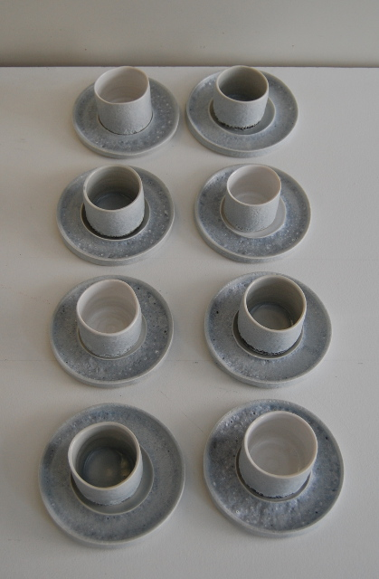 Eight porcelain cups and saucers
