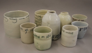 porcelain pots with text
